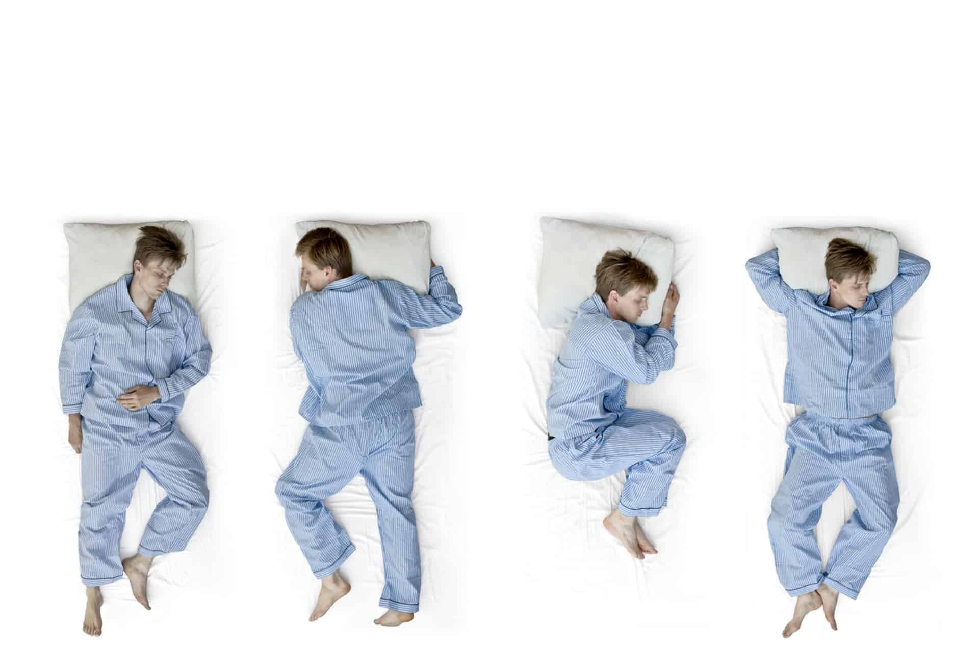 A man tries different sleeping positions in bed.