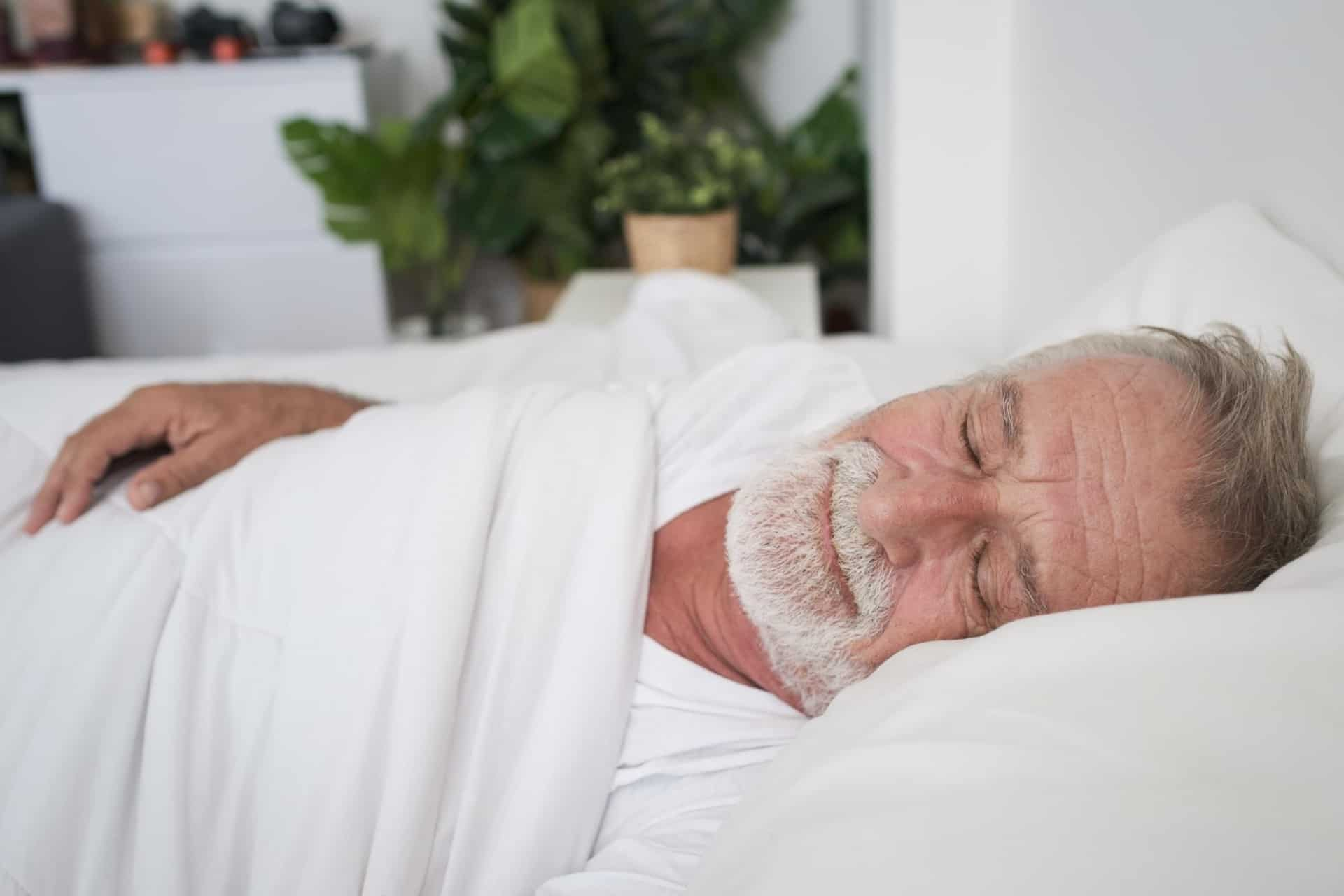 Older man sleeps well thanks to Inspire Therapy for sleep apnea.