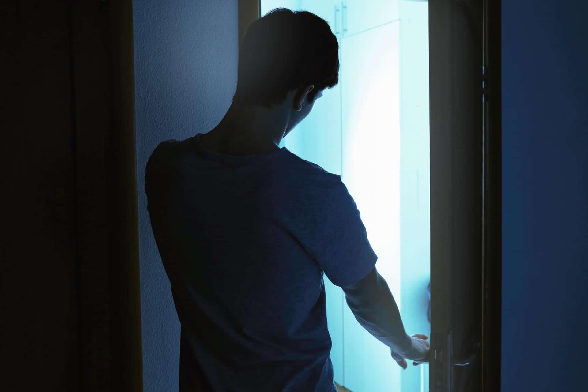 Man walks around bedroom while sleeping.