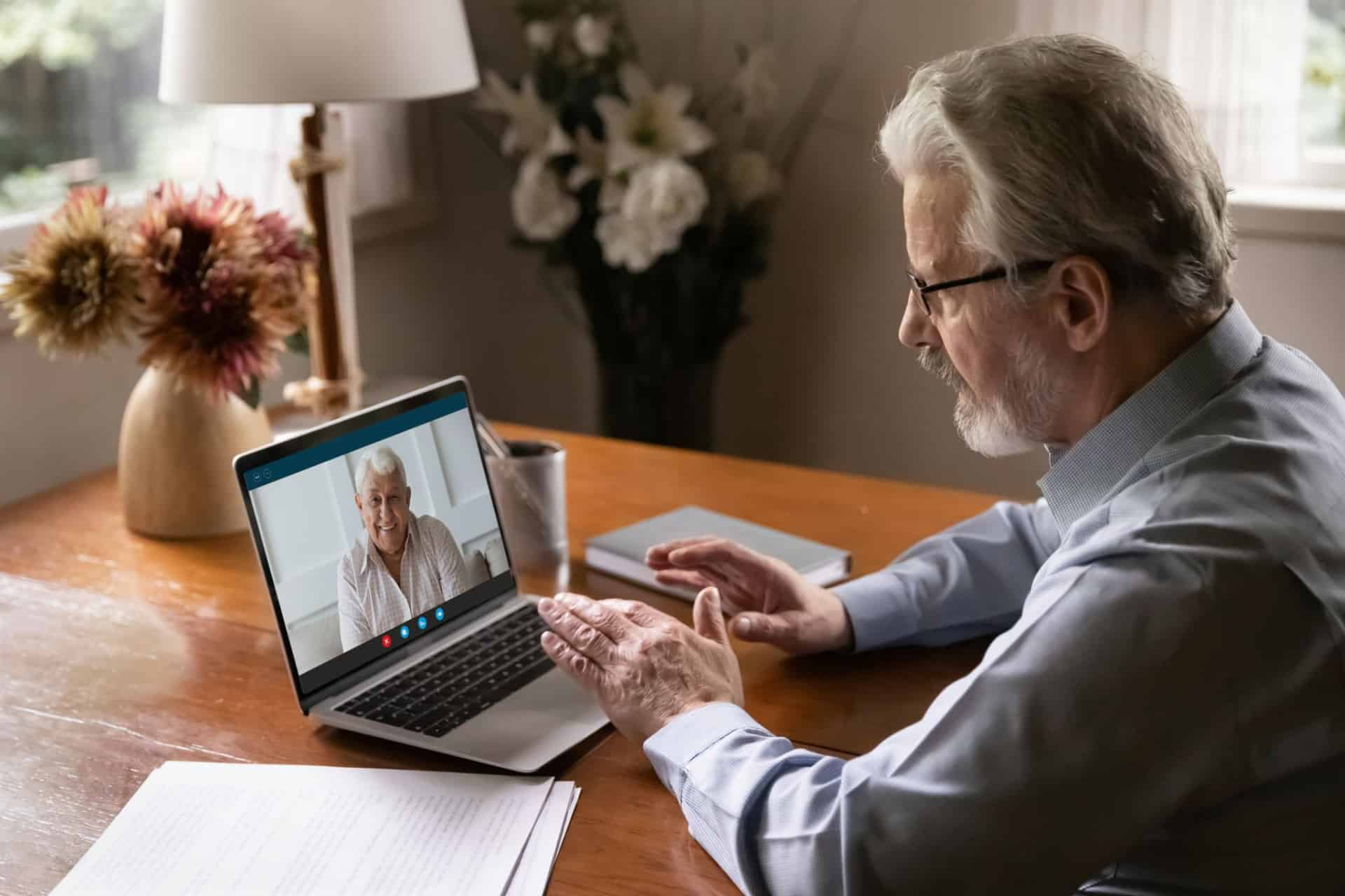 A clinical sleep specialist conducts a telehealth video call with someone who suffers from insomnia.